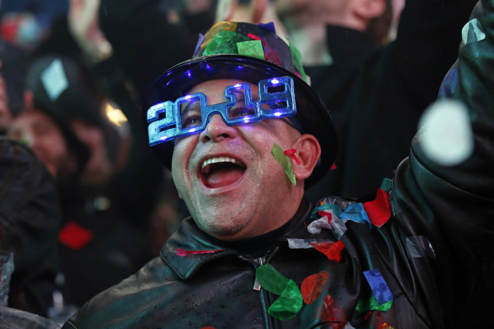 A reveler celebrates as confetti falls during a celebration of the new year in New York's Times Square in New York on Tuesday, Jan. 1, 2019, as they take part in a New Year's Eve celebration. (Adam Hunger/AP)