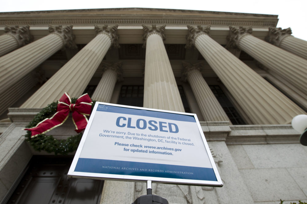 A closed sign is displayed at The National Archives entrance in Washington, Tuesday, Jan. 1, 2019, as a partial government shutdown stretches into its third week. A high-stakes move to reopen the government will be the first big battle between Nancy Pelosi and President Donald Trump as Democrats come into control of the House. (Jose Luis Magana/AP)