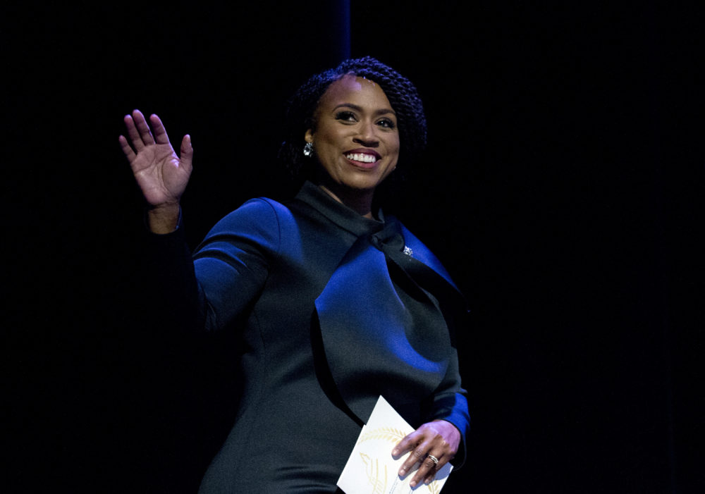 Ayanna Pressley waves to the audience during a swearing-in ceremony of the Congressional Black Caucus. (Jose Luis Magana/AP)