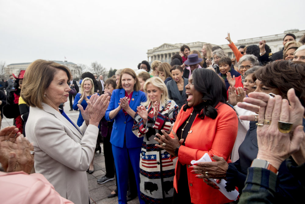 House Speaker Nancy Pelosi of Calif., left, applauds after a group portrait of the House Democratic women members of the 116th Congress on the East Front Capitol Plaza Capitol Hill in Washington, Friday, Jan. 4, 2019, as the 116th Congress begins. (Andrew Harnik/AP)
