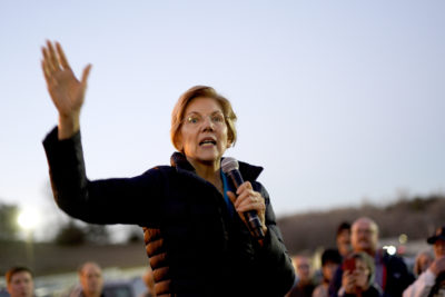 Sen. Elizabeth Warren, D-Mass, addresses an overflow crowd outside an organizing event at McCoy's Bar Patio and Grill in Council Bluffs, Iowa, Friday, Jan. 4, 2019. (Nati Harnik/AP)