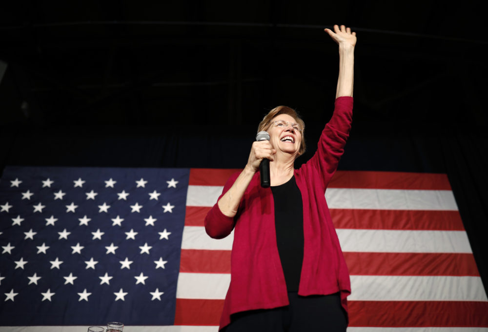 Sen. Elizabeth Warren, D-Mass, waves to the crowd during an organizing event at Curate event space in Des Moines, Iowa, Saturday, Jan. 5, 2019. (Matthew Putney/AP)