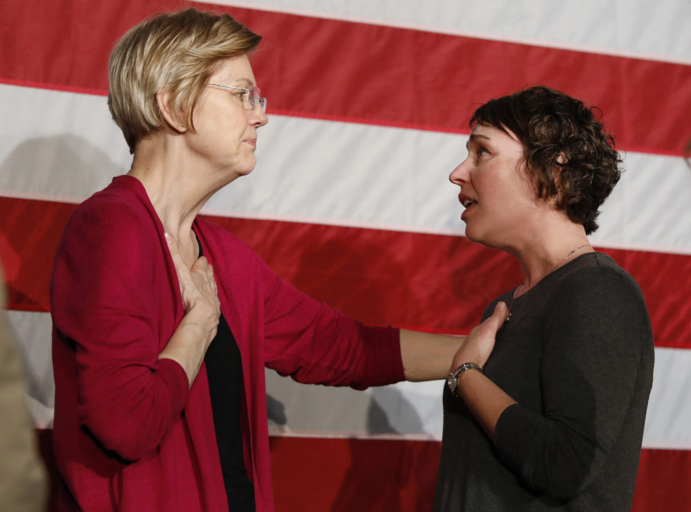 Sen. Elizabeth Warren, D-Mass., left, talks with Christa Lautner of Urbandale about student loans and predatory lending after an organizing event at Curate event space in Des Moines, Iowa, on Saturday. (Matthew Putney/AP)