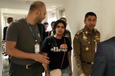 In this Jan. 7, 2019, file photo released by the Immigration Police, Chief of Immigration Police Maj. Gen. Surachate Hakparn, right, walks with Saudi woman Rahaf Mohammed Alqunun before leaving the Suvarnabhumi Airport in Bangkok, Thailand. (Immigration police via AP, File)