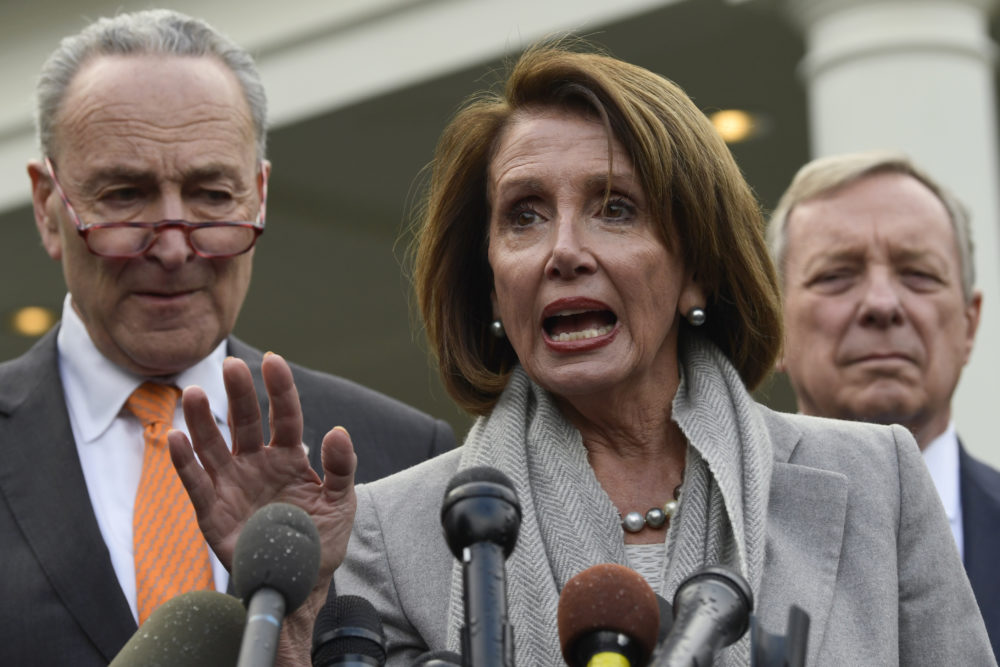 House Speaker Nancy Pelosi of Calif., center, speaks as she stands next to Senate Minority Leader Sen. Chuck Schumer of N.Y., left, and Sen. Dick Durbin, D-Ill., right, following their meeting with President Donald Trump at the White House in Washington, Wednesday, Jan. 9, 2019. (Susan Walsh/AP)