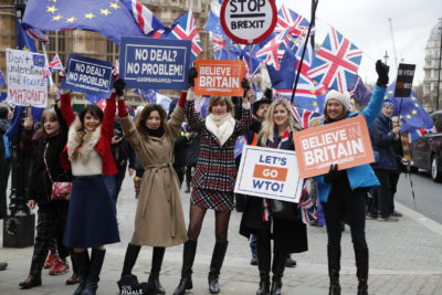 Leavers hold up signs next to pro-European demonstrators protesting opposite the Houses of Parliament in London, Tuesday, Jan. 15, 2019.(Frank Augstein/AP)