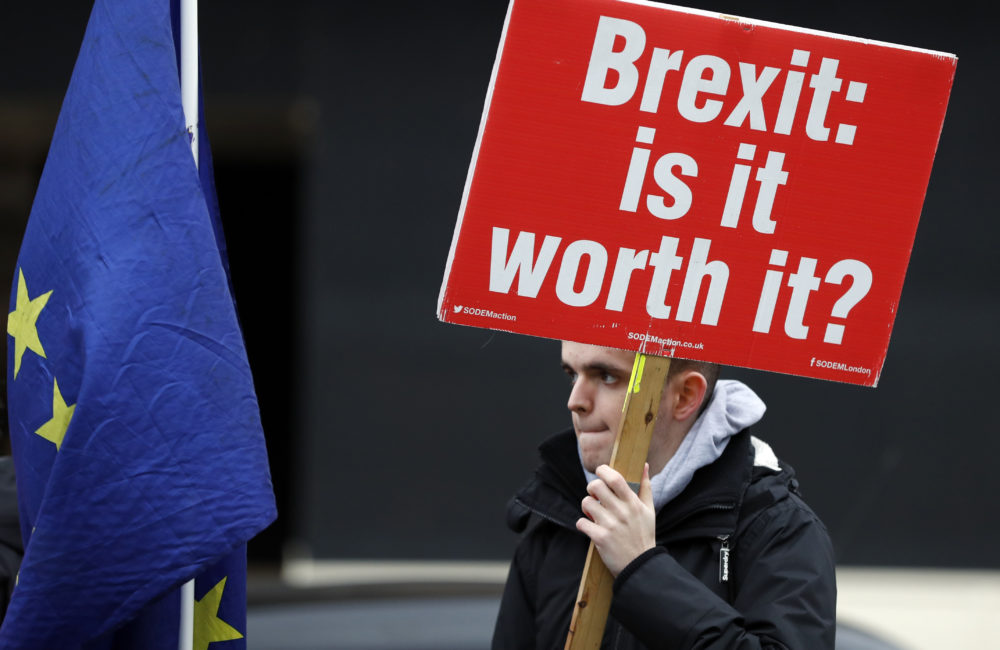 A protester holds a banner in London, Wednesday, Jan. 16, 2019. (Frank Augstein/AP)