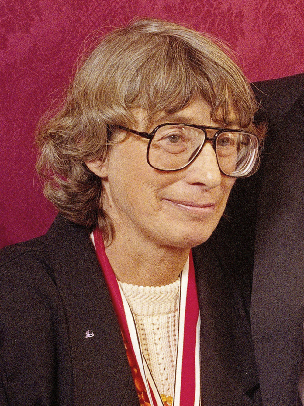 """FILE - In this Nov. 18, 1992 file photo, Mary Oliver appears at the National Book Awards in New York where she received the poetry award for her book """"New and Selected Poems."""" Oliver, a Pulitzer Prize-winning poet whose rapturous odes to nature and animal life brought her critical acclaim and popular affection, died Thursday at her home in Hobe Sound, Fla. The case of death was lymphoma. She was 83. (AP Photo/Mark Lennihan, File)"""