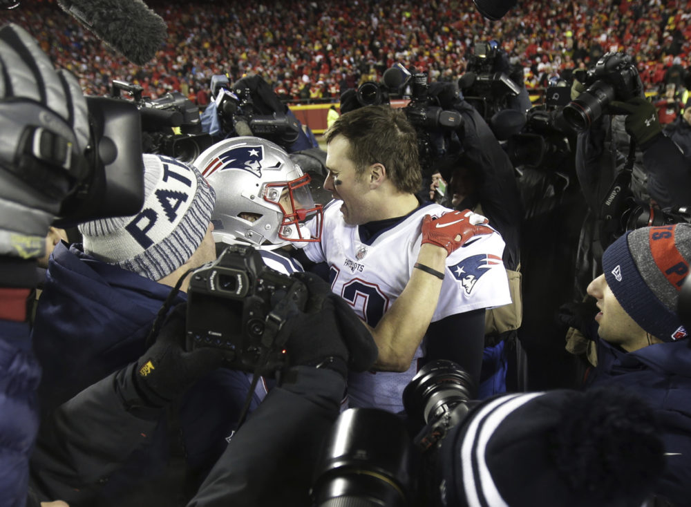 New England Patriots quarterback Tom Brady (12) celebrates with wide  receiver Chris Hogan after 1ce99bd07