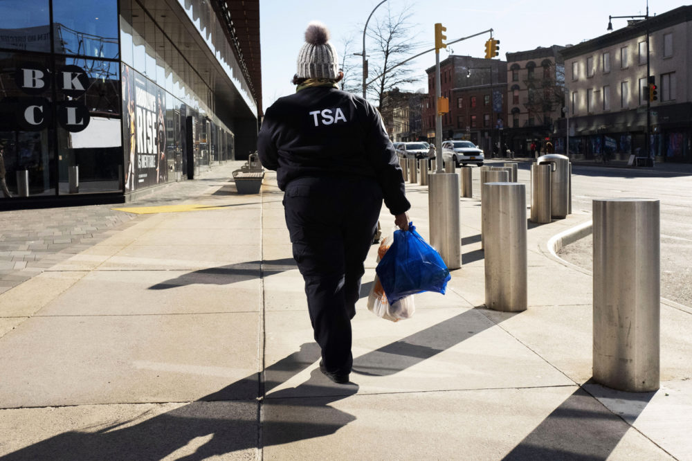 TSA worker Amelia Williams walks with bags of groceries after visiting a food bank for government workers affected by the shutdown, Tuesday, Jan. 22, 2019, in the Brooklyn borough of New York. (Mark Lennihan/AP)