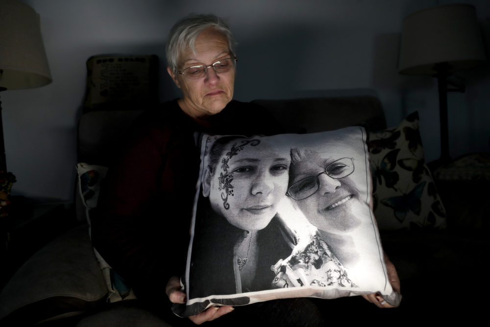 Deborah Fuller poses with a pillow showing a photo of her late daughter, Sarah Fuller, left, who passed away of a prescription drug overdose, and her during an interview in her home in West Berlin, N.J. The trial of a Insys Therapeutics Inc. founder John Kapoor, who is accused of scheming to bribe doctors into prescribing a powerful painkiller, is putting a spotlight on the nation's deadly opioid crisis. (Julio Cortez/AP)