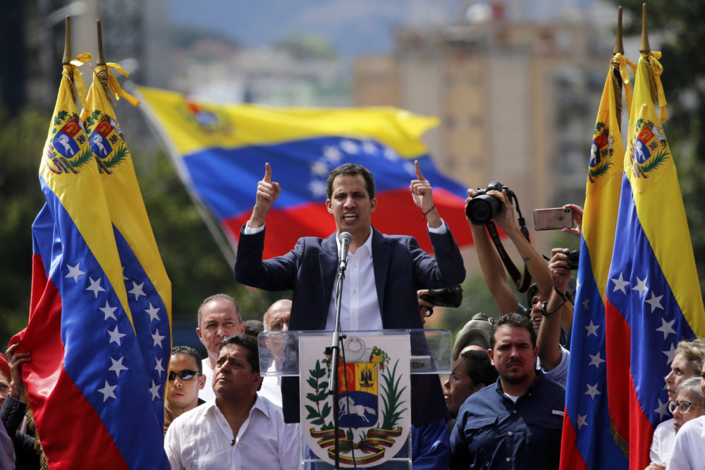 Juan Guaido, head of Venezuela's opposition-run congress, declares himself interim president of the nation until elections can be held during a rally demanding President Nicolas Maduro's resignation in Caracas, Venezuela, Wednesday, Jan. 23, 2019. (Fernando Llano/AP)