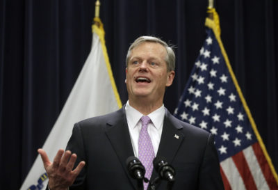 Massachusetts Gov. Charlie Baker faces reporters as he unveils his state budget proposal on Jan. 23, 2019. (Steven Senne/AP)