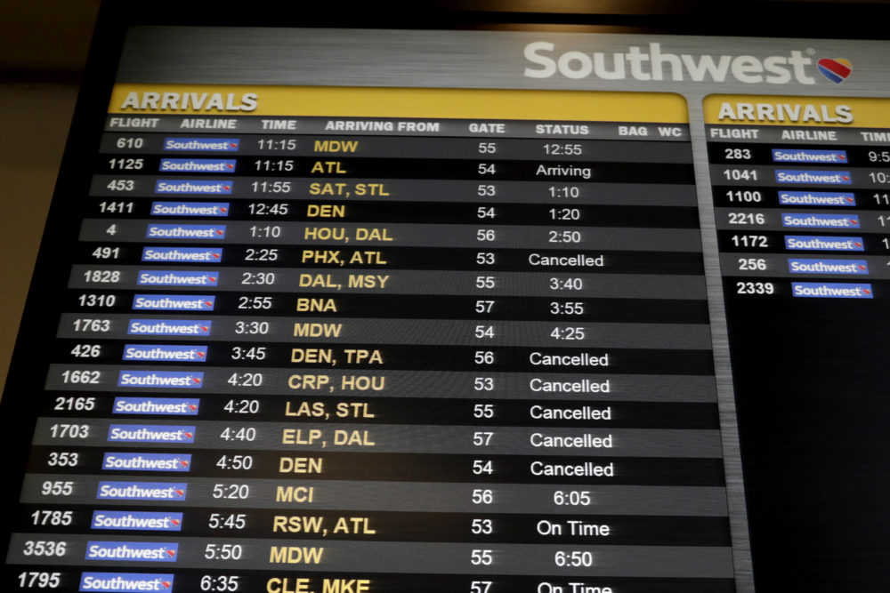 "Cancelled flights are seen on an arrivals board at the Southwest Airlines ticketing area at LaGuardia Airport, Friday, Jan. 25, 2019, in New York. The Federal Aviation Administration reported delays in air travel Friday because of a ""slight increase in sick leave"" at two East Coast air traffic control facilities. (Julio Cortez/AP)"