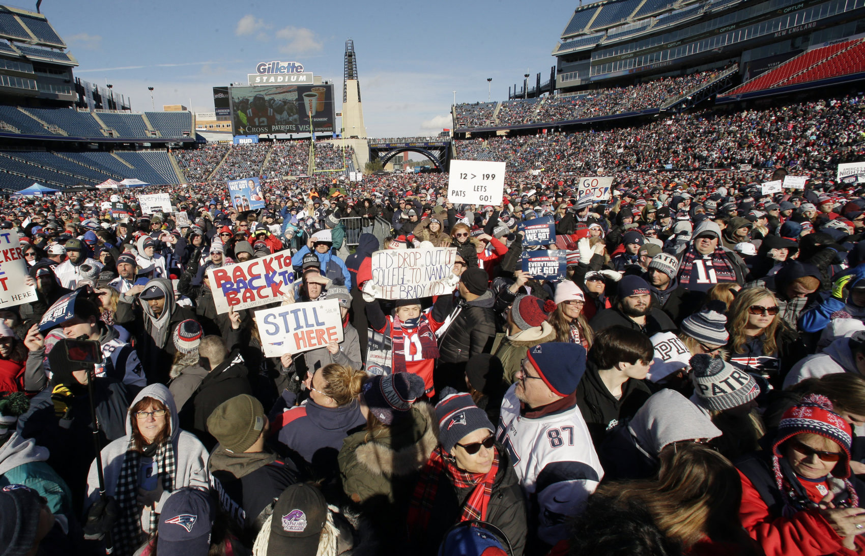 New England Patriots fans hold placards and cheer during an NFL football Super Bowl send-off rally for the team, Sunday, Jan. 27, 2019, in Foxborough, Mass. The Los Angeles Rams are to play the Patriots in Super Bowl on Feb. 3, in Atlanta, Ga. (Steven Senne/AP)
