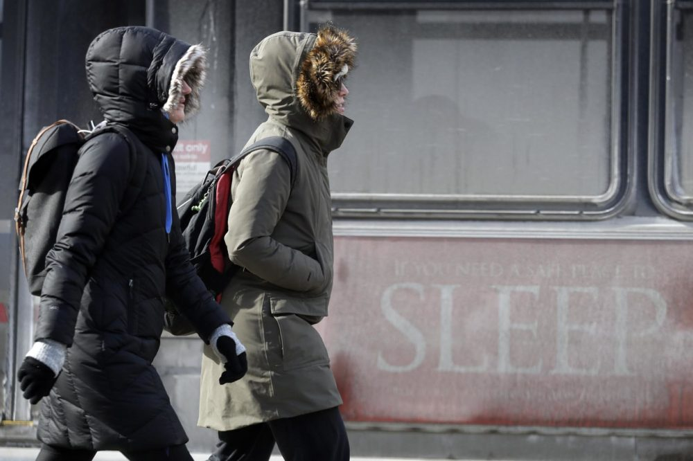 People are bundled up against the cold in downtown Chicago, Sunday, Jan. 27, 2019. (Nam Y. Huh/AP)
