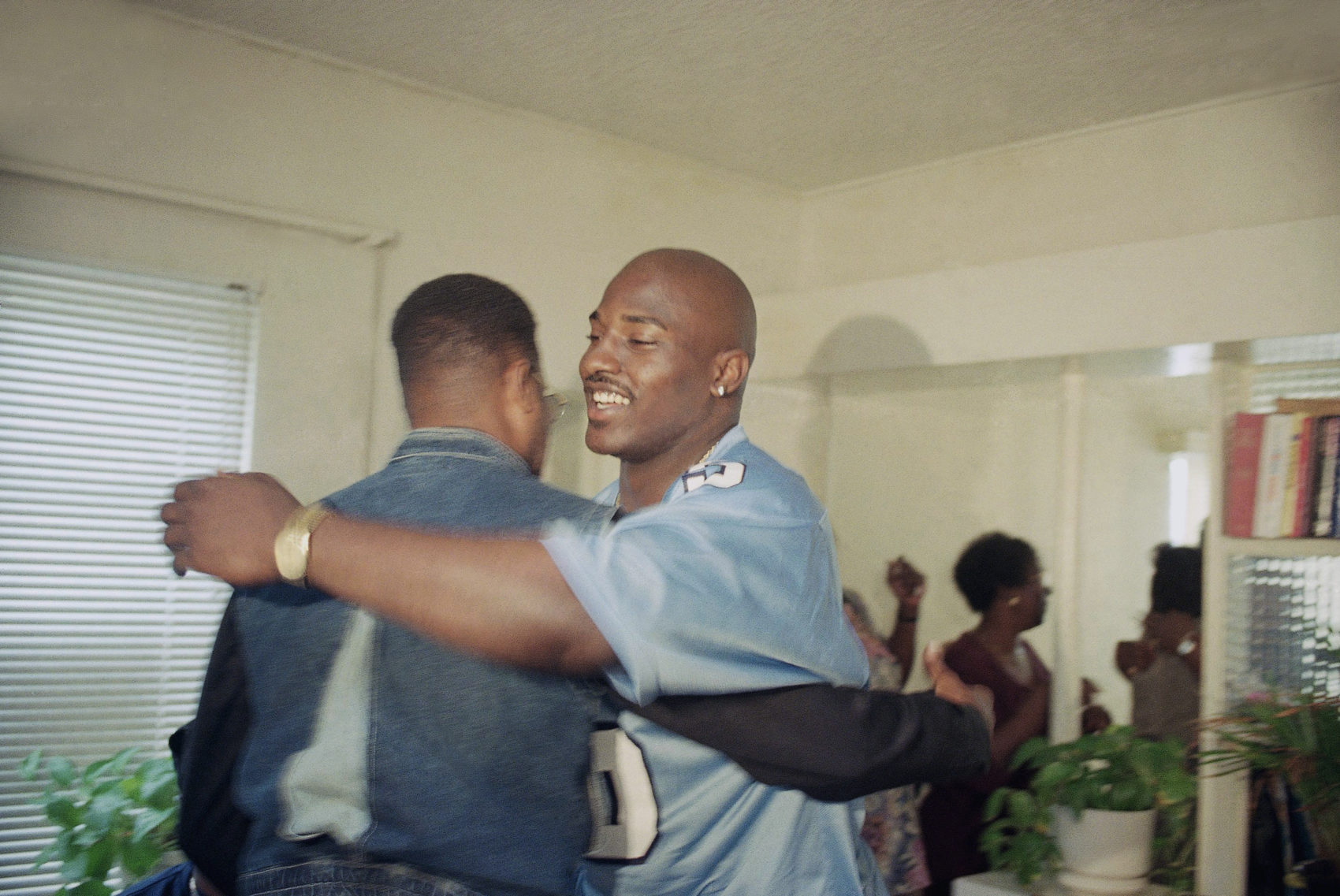 Wiley, donning his No. 5 Columbia jersey, celebrates being selected in the 1997 NFL Draft. (AP Photo/John Haynes)