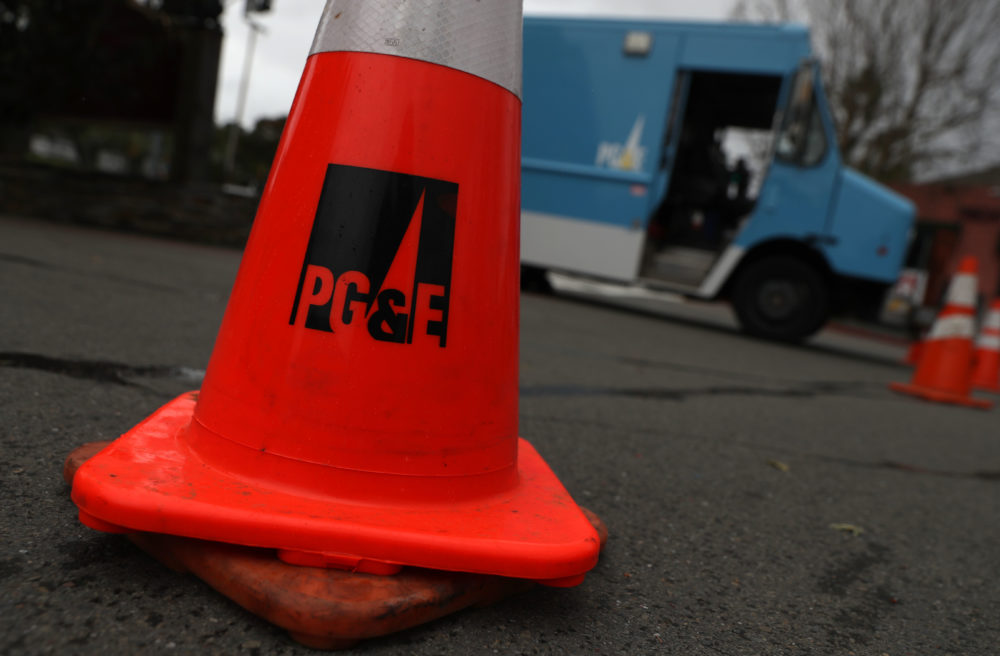 A traffic cone sits next to a Pacific Gas and Electric Company truck on Jan. 17, 2019 in Fairfax, Calif. PG&E announced that they are preparing to file for bankruptcy at the end of January as they face an estimated $30 billion in legal claims for electrical equipment that might have been responsible for igniting destructive wildfires in California. (Justin Sullivan/Getty Images)