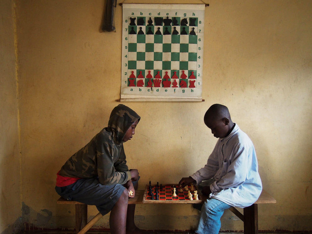 Children play at the Kampala chess club where Phiona Mutesi first learned the game. (Michele Siblioni/AFP/Getty Images)