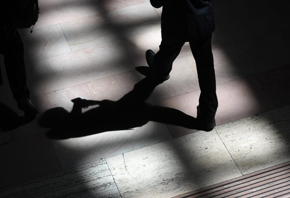 A man walks through the afternoon shadows on the tile floor at Grand Central Terminal in New York on Aug. 23, 2017.  (Timothy A. Clary/Getty Images)