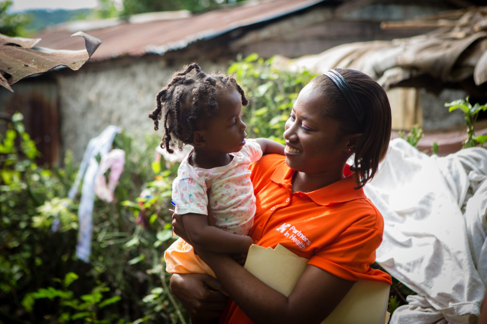 BOUCAN CARRE, HAITI - .  Nurse Asmine Pierre holds Maylove Louis, 14 months, during a home visit in Boucan Carré, Haiti. Louis is four months into the malnutrition program. (Courtesy Partners In Health)