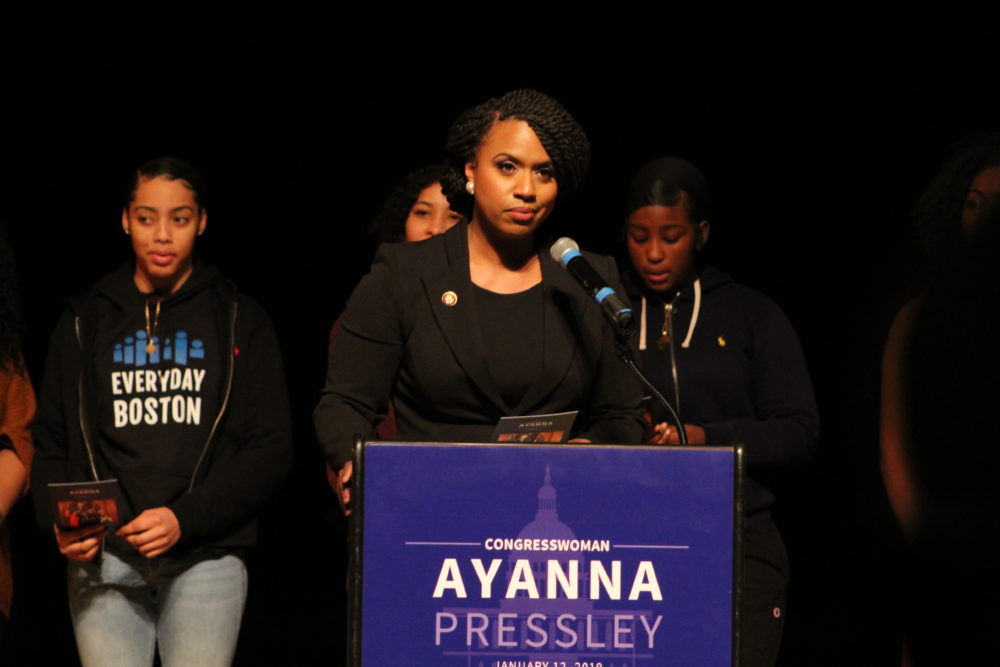 Ayanna Pressley addresses a crowd during her informal community swearing-in at Roxbury Community College. (Quincy Walters/WBUR)