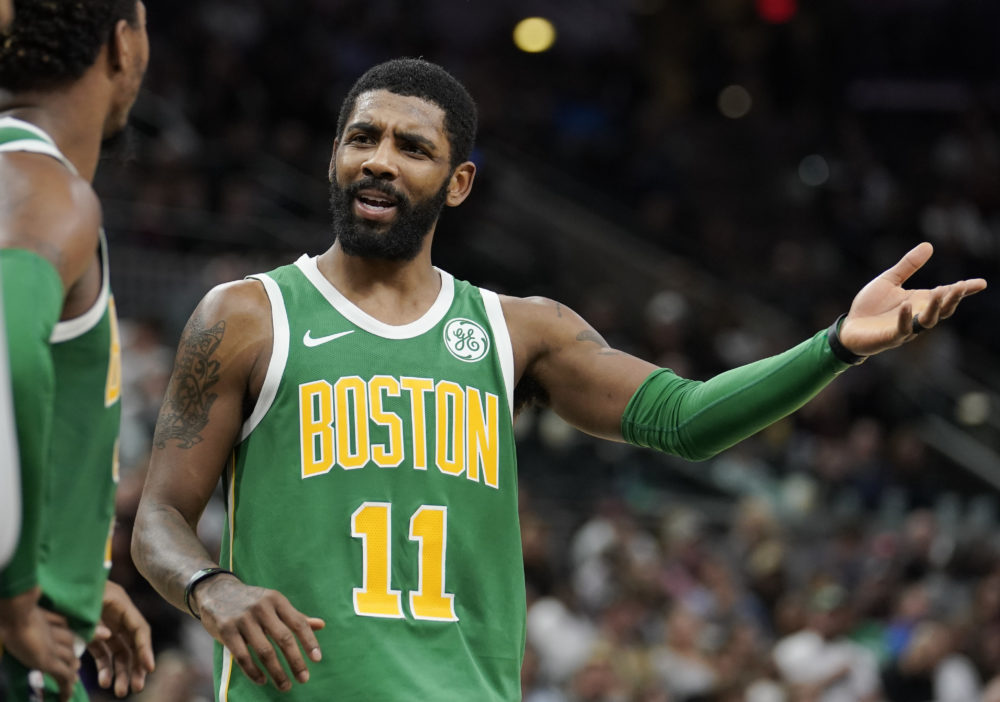 Boston Celtics' Kyrie Irving talks to teammate Marcus Smart during a recent basketball game. He's been in the news for his criticism of another teammate. (Darren