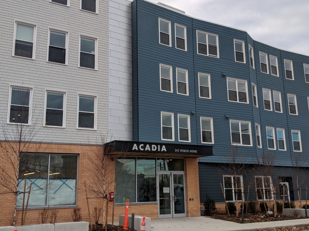 Rising housing costs and new upscale apartment buildings have local residents concerned about displacement and gentrification. The new Acadia apartment complex in Chelsea is ready to house 34 families. (Courtesy of Neighborhood Developers)