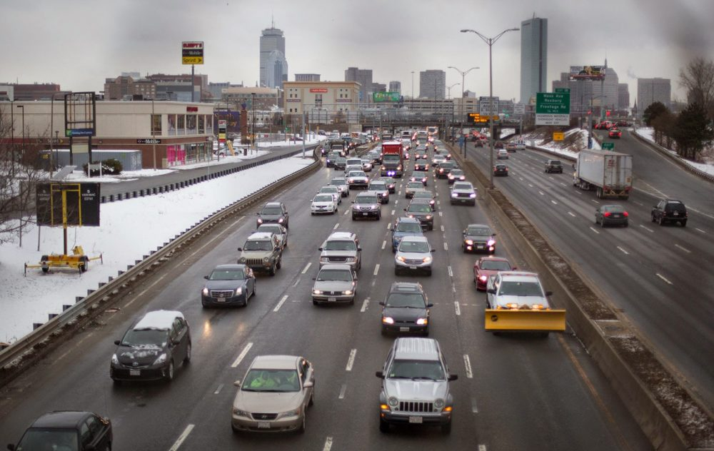 Heavy early afternoon traffic is seen on I-93 South as people head for home early ahead of a storm. (Robin Lubbock/WBUR)