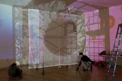 """German artist Otto Piene's """"Proliferation of the Sun,"""" a projected, multimedia performance from digitized hand-painted glass slides, is installed for an exhibit of Piene's work at the Fitchburg Art Museum. (Hadley Green for WBUR)"""