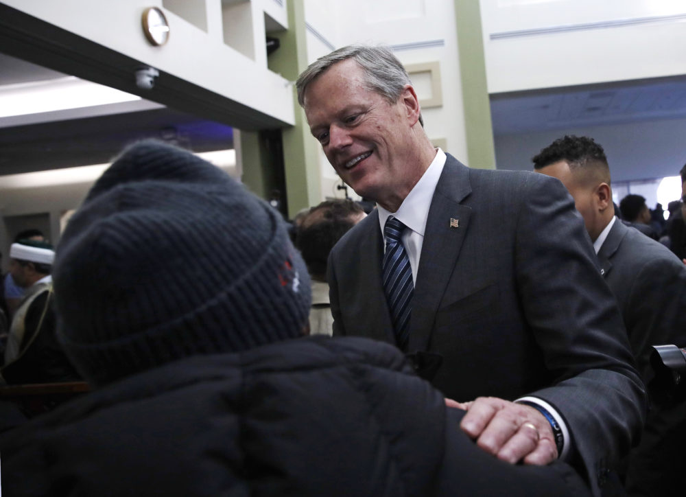 Massachusetts Gov. Charlie Baker, right, is greeted following prayer service at the Islamic Society of Boston Cultural Center's mosque in Boston on Friday. (Charles Krupa/AP)