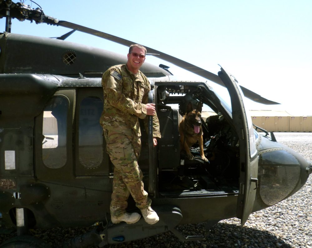Dyngo with his former handler, Staff Sgt. Justin Kitts, while on deployment in Afghanistan in 2011. (Courtesy of Justin Kitts)