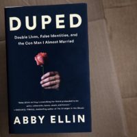 """Duped: Double Lives, False Identities, and the Con Man I Almost Married,"" by Abby Ellin. (Robin Lubbock/WBUR)"
