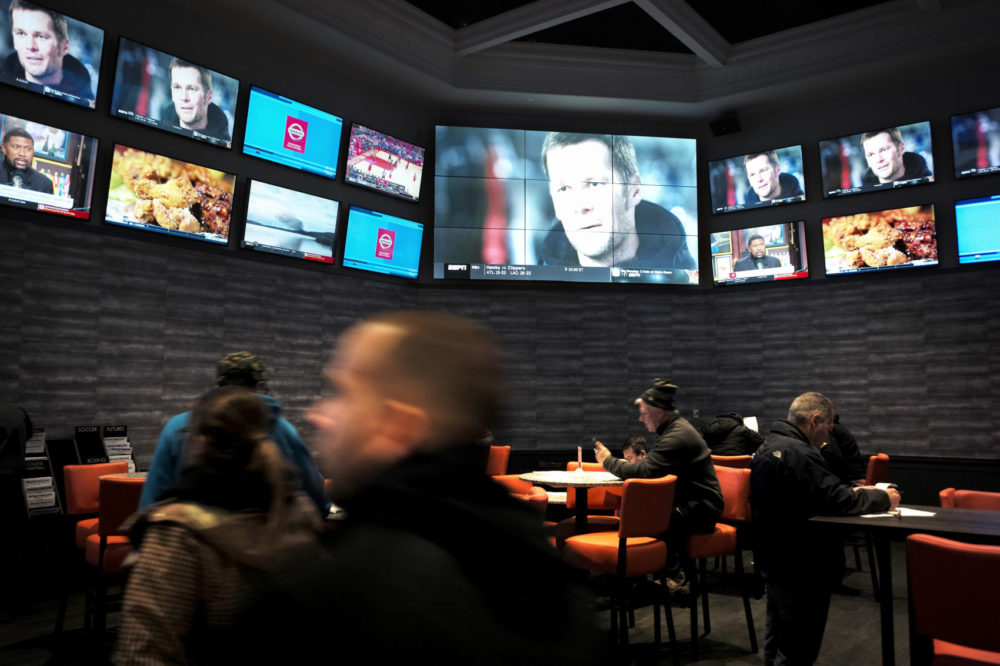 Patrons visit the sports betting area of Twin River Casino in Lincoln, R.I. on Jan. 28. (Steven Senne/AP)