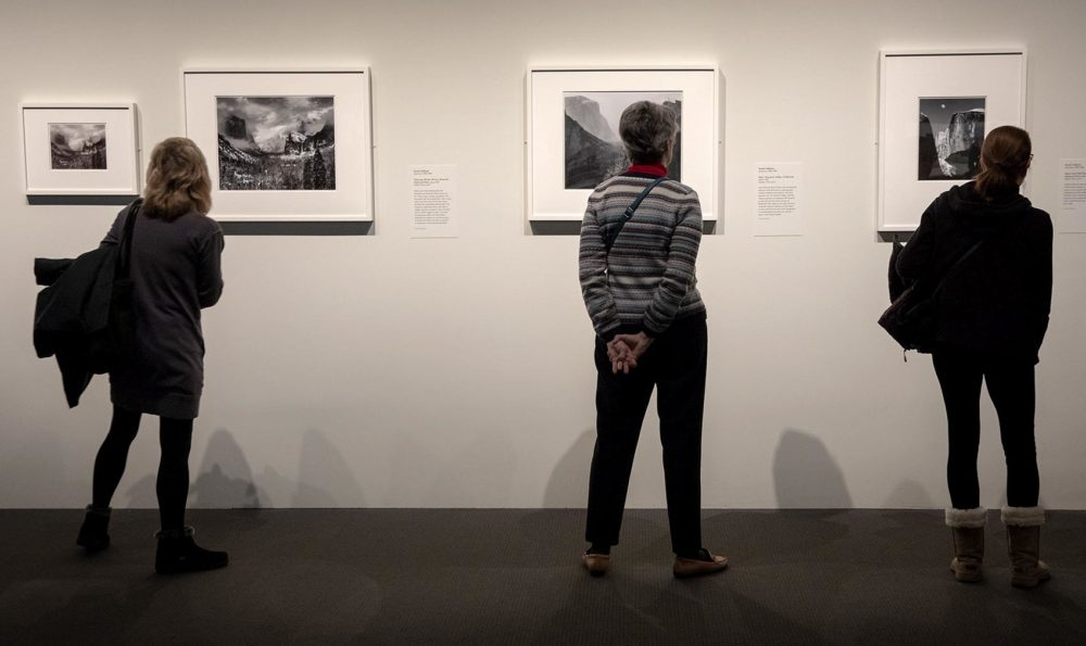 "Visitors at the MFA's ""Ansel Adams in Our Time"" exhibit. (Robin Lubbock/WBUR)"