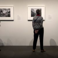 """Visitors at the MFA's """"Ansel Adams in Our Time"""" exhibit. (Robin Lubbock/WBUR)"""