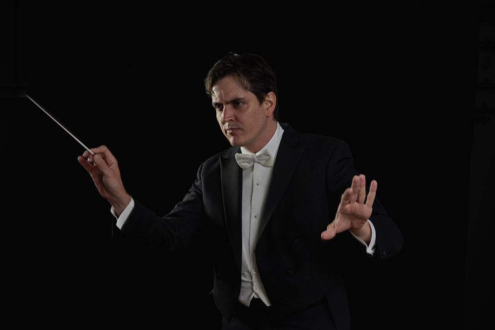 Carlos Izcaray, who was born in Venezuela, conducts the Alabama Symphony Orchestra during a performance. (Courtesy of the Alabama Symphony Orchestra)