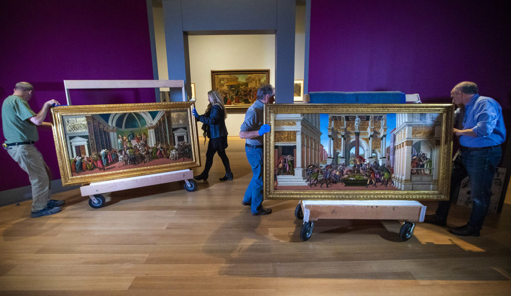 "Curators at the Isabella Stewart Gardner Museum inspect and arrange the ""The Tragedy of Lucretia"" and ""The Story of Virginia"" by Sandro Botticelli (Jesse Costa/WBUR)"