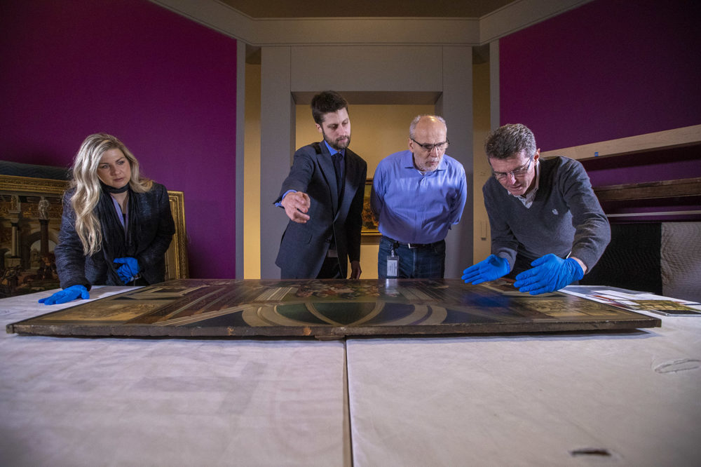 Head Registrar for Collection and Exhibitions at the Isabella Stewart Gardner Museum Amanda Prugh Venezia, William and Lia Poorvu Curator of the Collection Nathaniel Silver, Chief Conservator Gianfranco Pocobene and Accademia Carrara Museum curator Giovanni Valagussa analyze the Botticelli paintings. (Jesse Costa/WBUR)