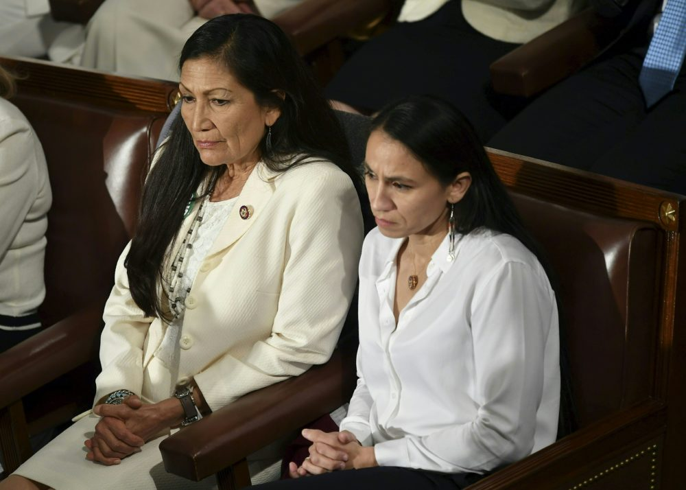 Reps. Deb Haaland (D-N.M., left) and Sharice Davids (D-Kan.) watch during President Trump's State of the Union address at the U.S. Capitol in Washington, D.C., on Feb. 5, 2019. (Mandel Ngan/AFP/Getty Images)