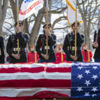The body of veteran James McCue was buried with full military honors at Bellevue Cemetery in Lawrence. (Jesse Costa/WBUR)