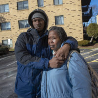 Malique Gordon, left, lives with his mother, Maureen Nugent, who receives a Section 8 housing voucher. They've had a mixed experience with the program. (Jesse Costa/WBUR)