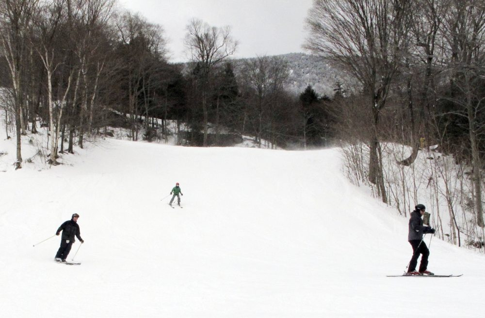 "Vermont has made news recently with its efforts to expand its population and combat a critical shortage of skilled labor. Among the initiatives? ""Stay to Stay Ski Weekends."" Pictured: Skiers descend a slope at Mad River Glen in Fayston, Vt. (Lisa Rathke/AP)"