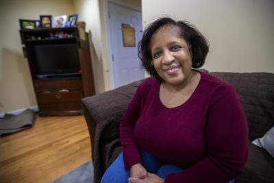 Alma Chisholm's Dorchester apartment building was purchased out of foreclosure by a newly formed nonprofit. (Jesse Costa/WBUR)