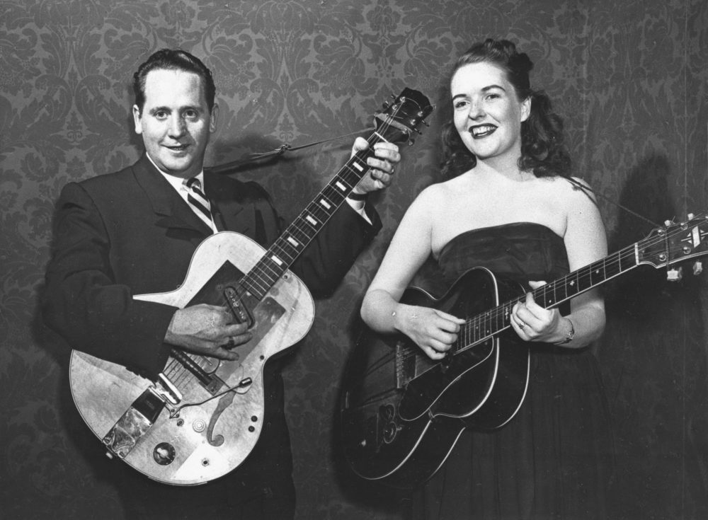 Les Paul and his wife, Mary Ford, strum their guitars on Nov. 5, 1951. (AP Photo)