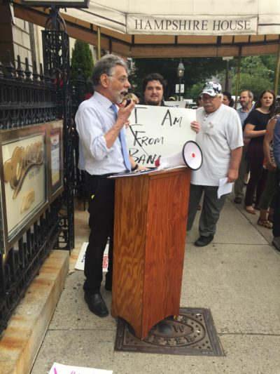 Restuccia speaks at a rally outside of the Hampshire House during a fundraiser for former U.S. Rep. Bruce Poliquin, (R-Maine), the only member of the New England congressional delegation who voted to repeal the Affordable Care Act. (Courtesy Community Catalyst)