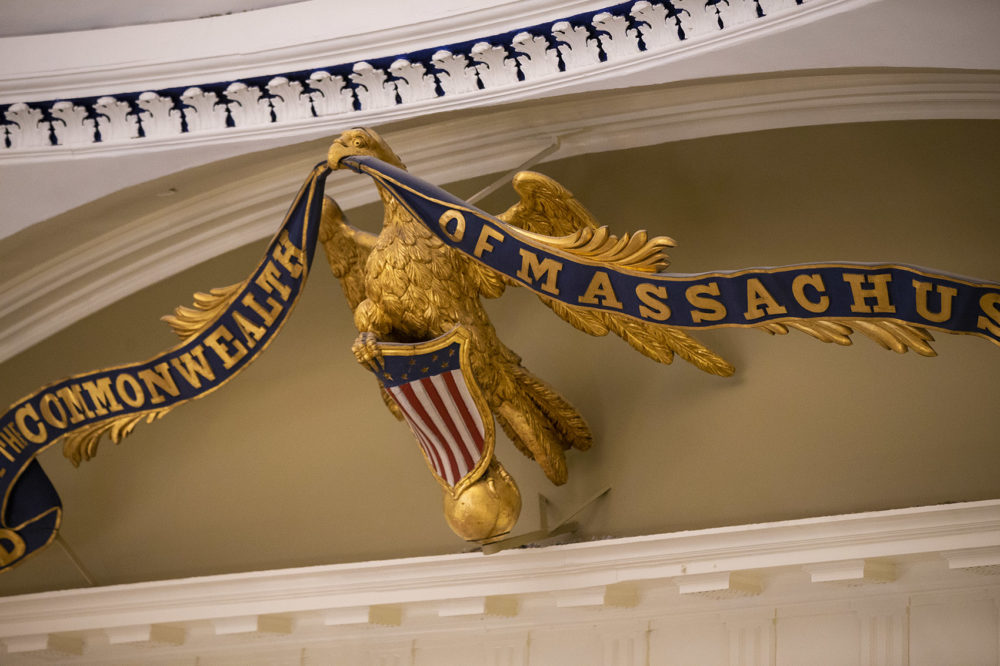 "The banner reading, ""God Save the Commonwealth of Massachusetts"" in the eagle's mouth, was removed and refurbished. However, the eagle posed too many problems to be removed. It was repainted on the wall. (Jesse Costa/WBUR)"