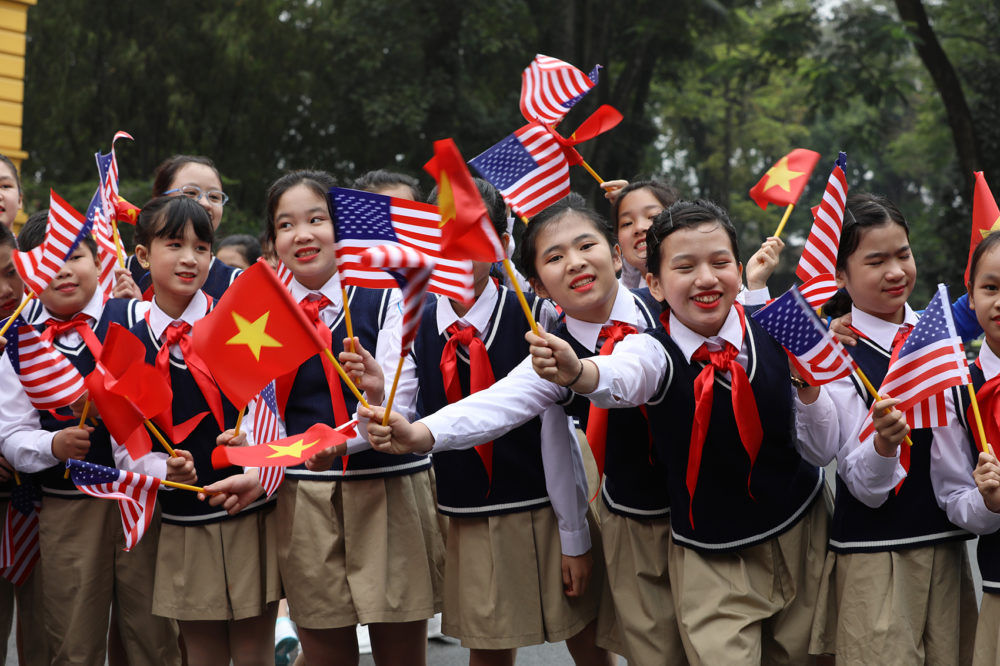 Vietnamese children wave flags before the arrival of President Trump at the Presidential Palace on Feb. 27, 2019 in Hanoi, Vietnam. (Dien Bien/Getty Images)