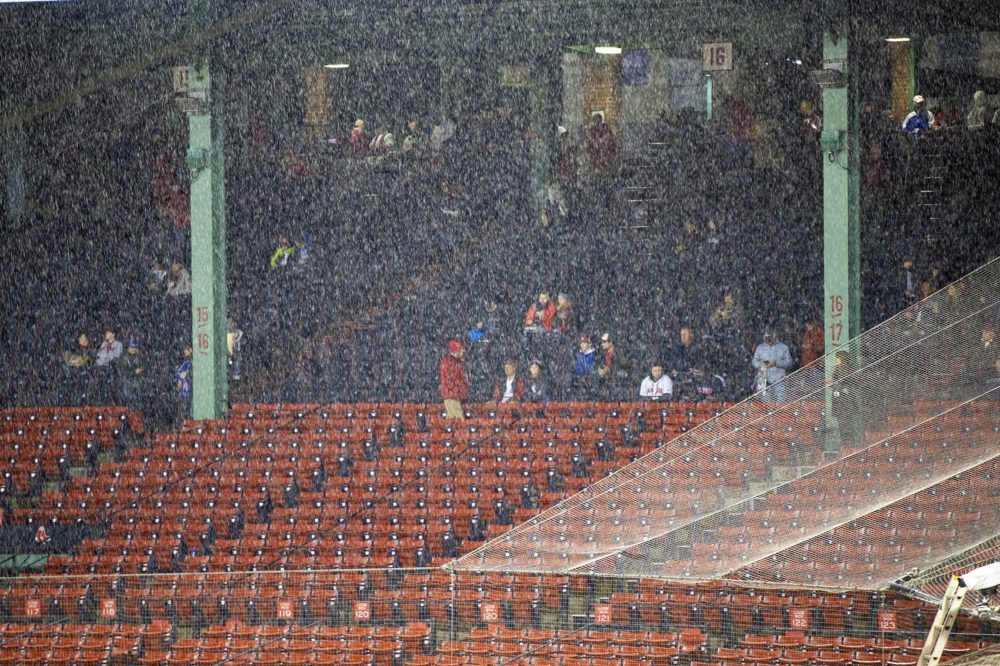 Last year was Massachusetts' rainiest on record. Here, rain falls at Fenway Park before a World Series game. (Jesse Costa/WBUR)
