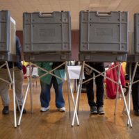 Voters fill the booths at a polling station in Watertown, Mass. (Robin Lubbock/WBUR)